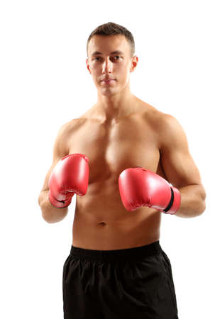 fortitude: Handsome young muscular sportsman with boxing gloves isolated on white Stock Photo