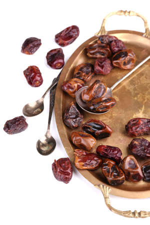 dates fruit: Tasty dates fruits on old metal tray, isolated on white
