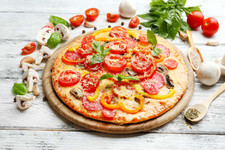 Delicious pizza served on wooden table Archivio Fotografico
