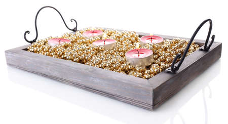 Candles on vintage tray with decorative beads, isolated on white photo