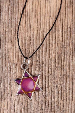 judah: Star David pendant on wooden background