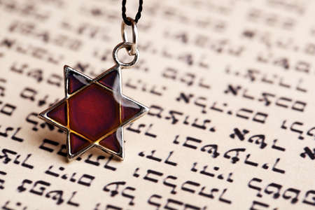 magen david: Star David pendant on old paper page background