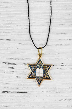 star of david: Star David pendant on wooden background