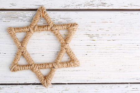 jewish star: Star of David on wooden background Stock Photo