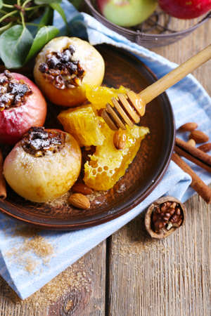 Baked apples on plate on table close up photo