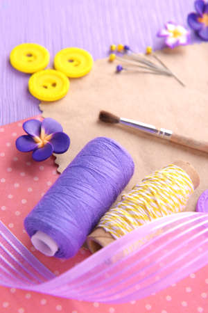 Scrapbooking craft materials on bright background photo
