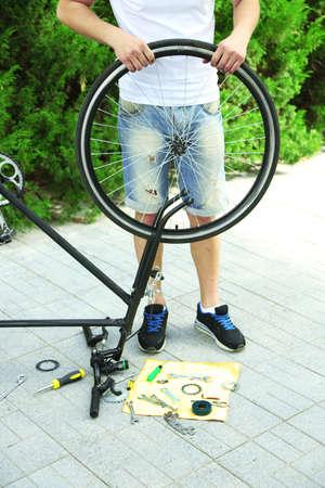 Man repairing his bike, close-up photo