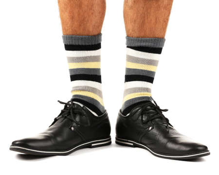 Man leg in suit and colorful socks, isolated on white Stock Photo