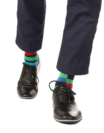 Man leg in suit and colorful socks, isolated on white photo