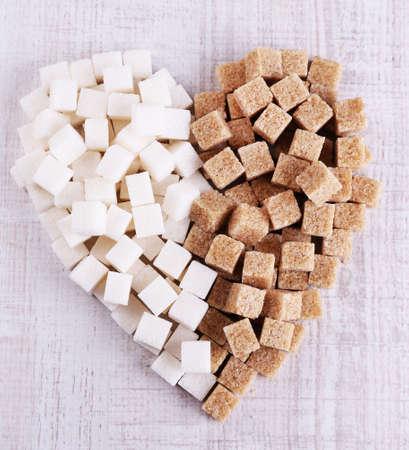 brown sugar: Sugar heart on wooden background