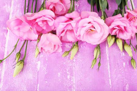 Beautiful eustoma flowers on wooden  photo
