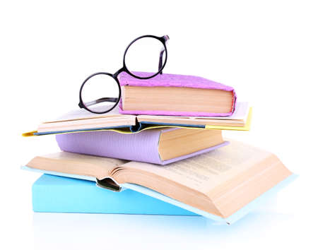 book binding: Books in a mess and glasses isolated on white