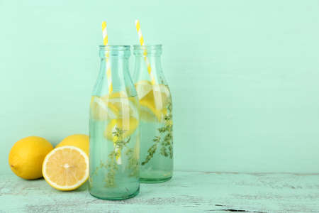 water thyme: Tasty cool beverage with lemon and thyme, on wooden background Stock Photo