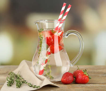 water thyme: Tasty cool beverage with strawberries and thyme, on light background Stock Photo