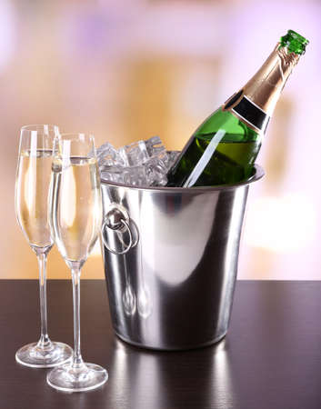 Champagne in glasses and bottle in restaurant