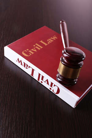 Civil Law book with hammer on wooden table photo