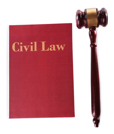 Civil Law book with scales and hammer isolated on white photo