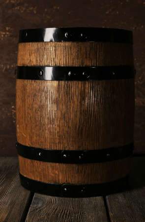 Barrel on wooden table on wooden wall background photo