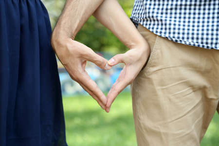 valentine married: Loving couple holding hands outdoors Stock Photo
