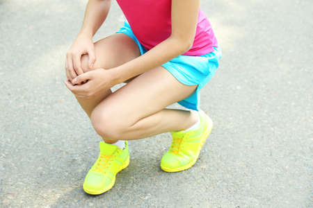 Sports injuries of girl outdoors photo