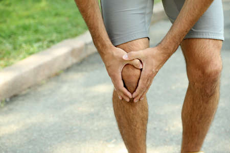 Sports injuries of man outdoors photo