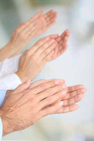 acknowledgment: Clapping hands on bright background Stock Photo