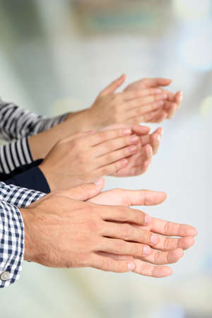 Clapping hands on bright background Stock Photo