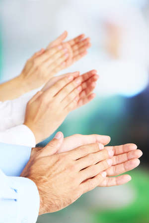 extol: Clapping hands on bright background Stock Photo