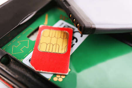 cell phone and sim card, close up photo