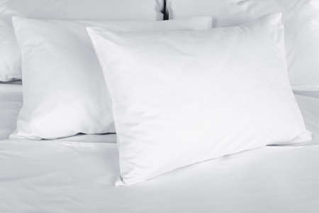 White pillows on bed close up Stock Photo