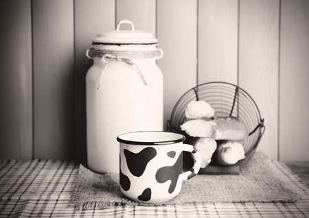 Retro still life with tasty rustic milk, on table photo