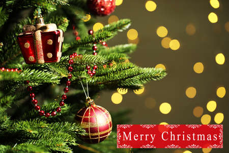 Decorated Christmas tree on  blurred, sparkling and fairy background photo