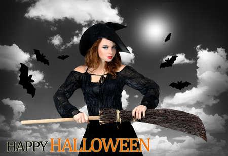 grey  sky: Halloween witch with broom on grey sky background