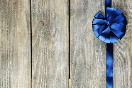 grange: Old wooden background with beautiful bow