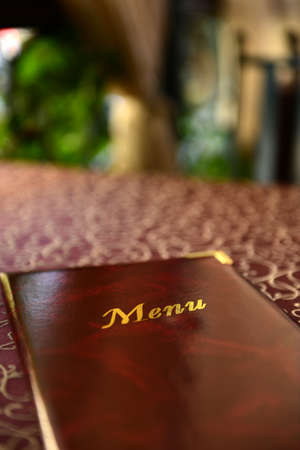 Menu book on table in restaurant photo