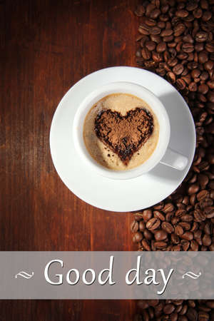 Cup of coffee with coffee beans on wooden background photo