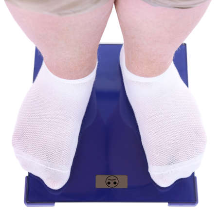 overeating: Fat man standing on electronic scales isolated on white. Conceptual photo of weight loss. Stock Photo