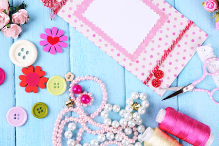 brads: Scrap booking craft materials on color wooden  Stock Photo