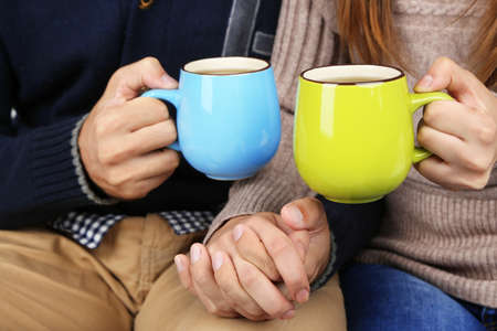 hot love: Loving couple with hot drinks Stock Photo