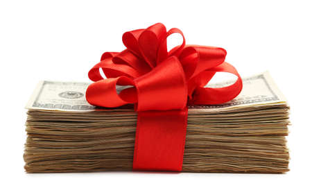 christmas bonus: Bundle of dollars tied with ribbon isolated on white