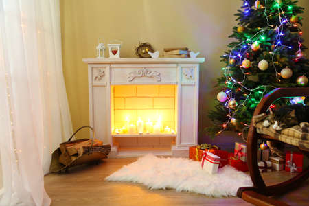 Cute cat on rocking chair in the front of the fireplace photo