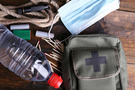 emergency kit: Emergency preparation equipment on wooden background