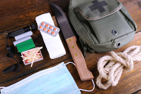 firstaid: Emergency preparation equipment on wooden background
