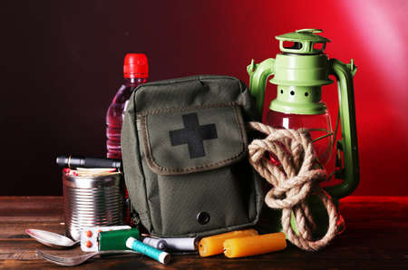 emergencies and disasters: Emergency preparation equipment on wooden table, on dark background
