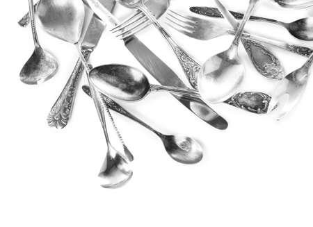 grunge flatware: Disordered tableware isolated on white Stock Photo