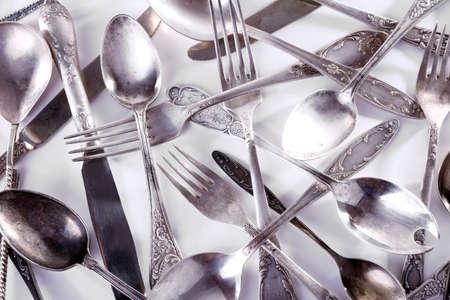 grunge flatware: Disordered tableware closeup Stock Photo