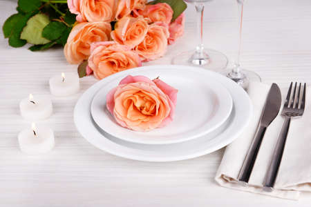 stemware: Table setting with pink rose on plate