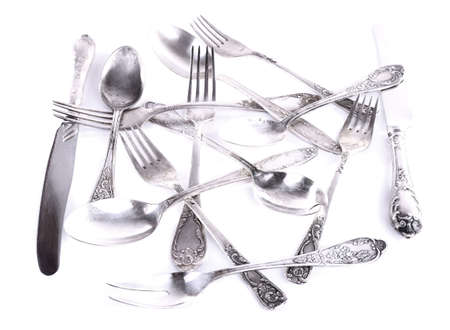 disordered: Disordered tableware isolated on white Stock Photo
