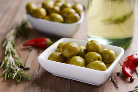 Marinated olives on table close-up photo