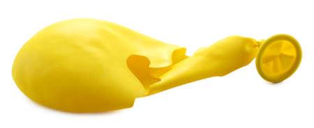popped: Popped yellow balloon isolated on white Stock Photo